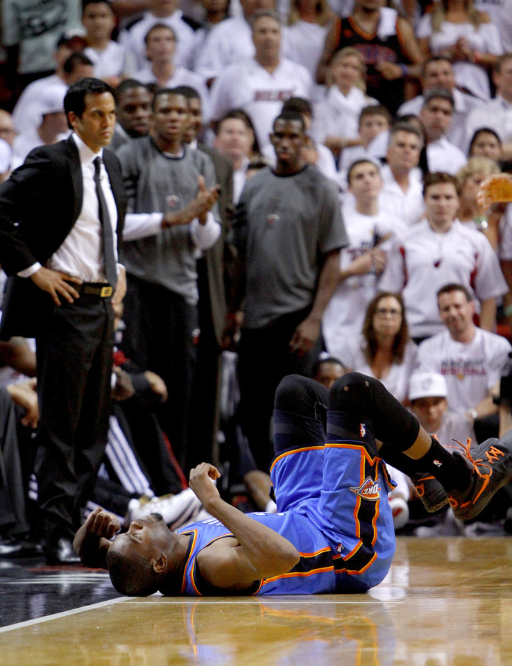 Photo - Oklahoma City's Kevin Durant (35) falls down during Game 5 of the NBA Finals between the Oklahoma City Thunder and the Miami Heat at American Airlines Arena, Thursday, June 21, 2012. Oklahoma City lost 121-106. Photo by Bryan Terry, The Oklahoman