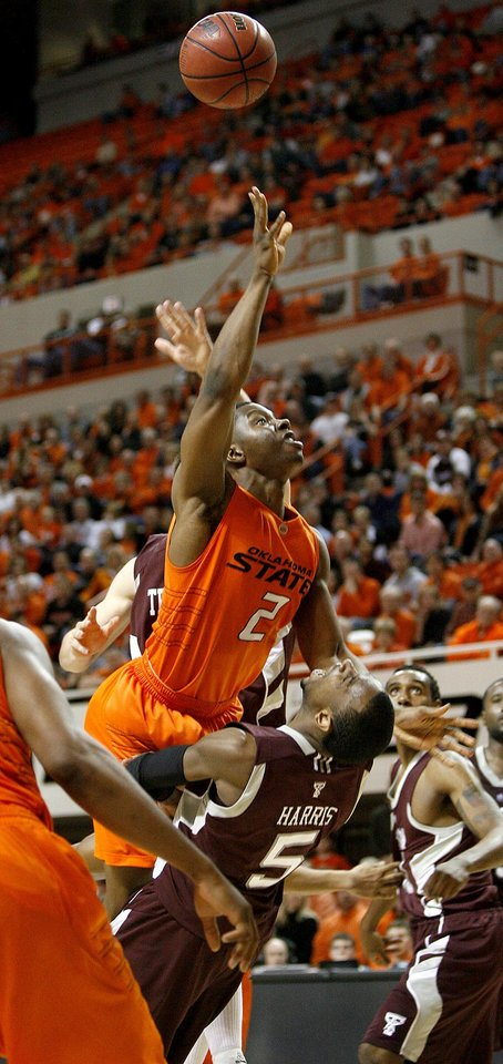 Photo - OSU's Obi Muonelo runs into Texas A&M's Dash Harris during an NCAA college basketball game between the Oklahoma State University and Texas A&M at Gallagher-Iba Arena in Stillwater, Okla., Wednesday, January 27, 2010. Photo by Bryan Terry, The Oklahoman
