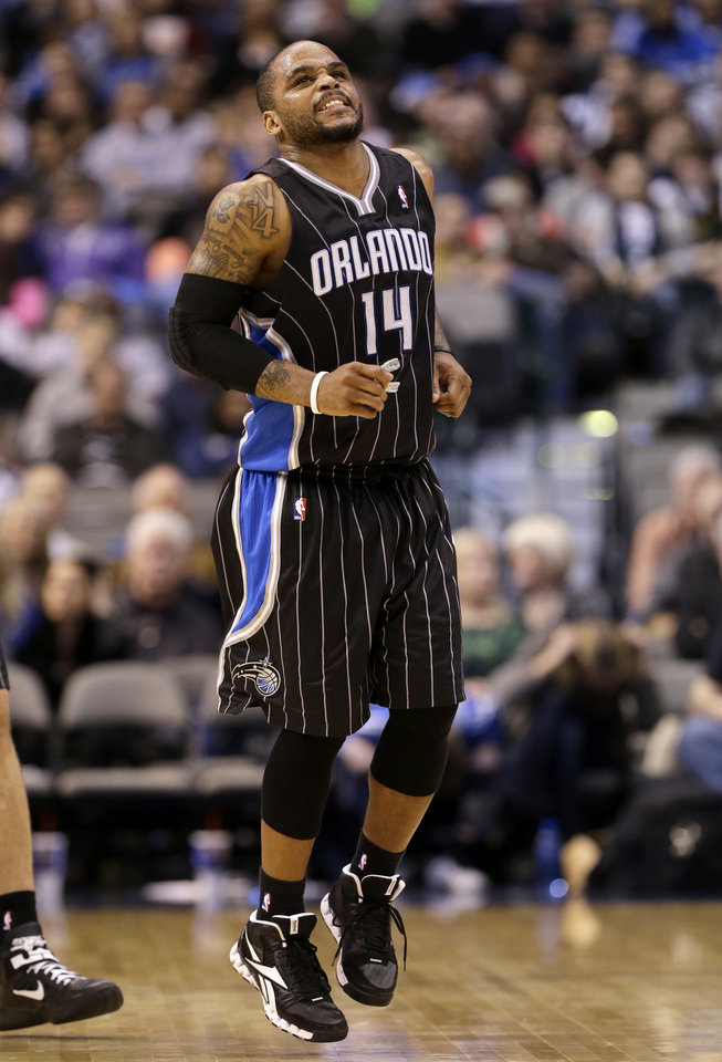 Orlando Magic's Jameer Nelson hops off the court after wrestling on the court for a loose ball against Dallas Mavericks' Darren Collison in the second half of an NBA basketball game Wednesday, Feb. 20, 2013, in Dallas. Nelson left the game. The Mavericks won 111-96. (AP Photo/Tony Gutierrez)