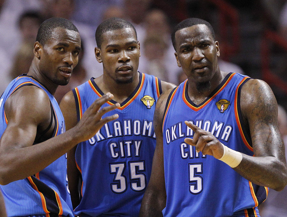 Oklahoma City Thunder power forward Serge Ibaka (9) from Republic of Congo, small forward Kevin Durant (35) and center Kendrick Perkins (5) react during the first half at Game 5 of the NBA finals basketball series against the Miami Heat, Thursday, June 21, 2012, in Miami. (AP Photo/Lynne Sladky)