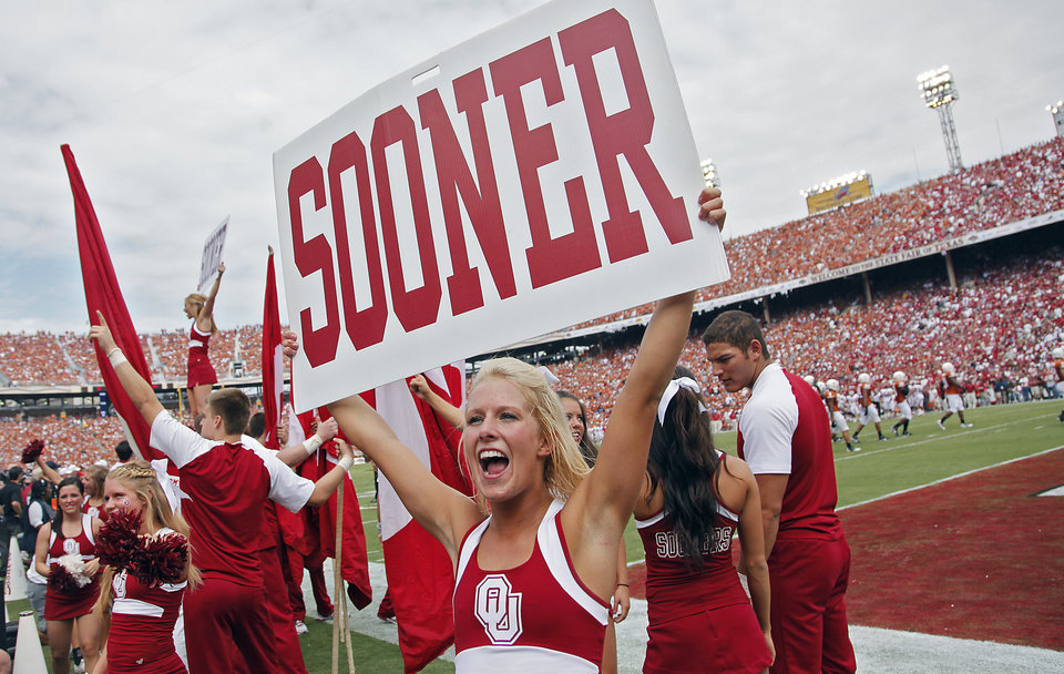 Photo - A member of the Oklahoma pom squad cheer on the fans during the Red River Rivalry college football game between the University of Oklahoma Sooners (OU) and the University of Texas Longhorns (UT) at the Cotton Bowl in Dallas, Saturday, Oct. 8, 2011. Photo by Chris Landsberger, The Oklahoman