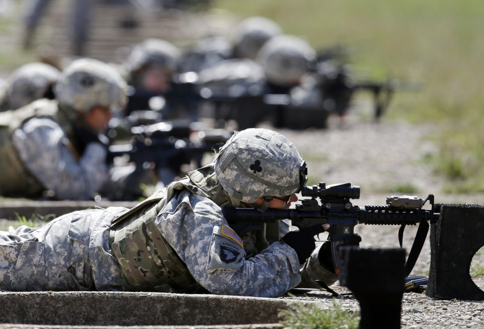 FILE - In this Sept. 18, 2012 file photo, female soldiers from 1st Brigade Combat Team, 101st Airborne Division train on a firing range while testing new body armor in Fort Campbell, Ky., in preparation for their deployment to Afghanistan. Women served and died on the nation�s battlefields from the first. They were nurses and cooks, spies and couriers in the Revolutionary War. Some disguised themselves as men to fight for the Union or the Confederacy. Yet the U.S. military�s official acceptance of women in combat took more than two centuries. New roles for females were doled out fitfully _ whenever commanders got in a bind and realized they needed women�s help. A look at milestones on the way to lifting the ban on women in ground combat.  (AP Photo/Mark Humphrey, File)