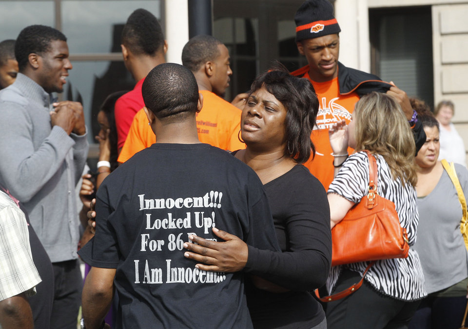 "Mildred Williams, right, an aunt to Darrell Williams, embraces a supporter outside the courthouse in Stillwater, Okla., Friday, Oct. 12, 2012, following a sentencing hearing. Supporters had packed the courtroom for Williams' sentencing, some wearing black T-shirts that said ""Free Darrell 25."" Williams' uniform number was 25. On the back, the shirts said, ""Innocent!!!, Locked Up! For 86 Days, I Am Innocent!!!"" Ex-Oklahoma State basketball player Darrell Williams avoided more time behind bars Friday when a judge gave him a suspended sentence in a sexual assault case in which Williams insisted he was innocent. (AP Photo/Sue Ogrocki)"