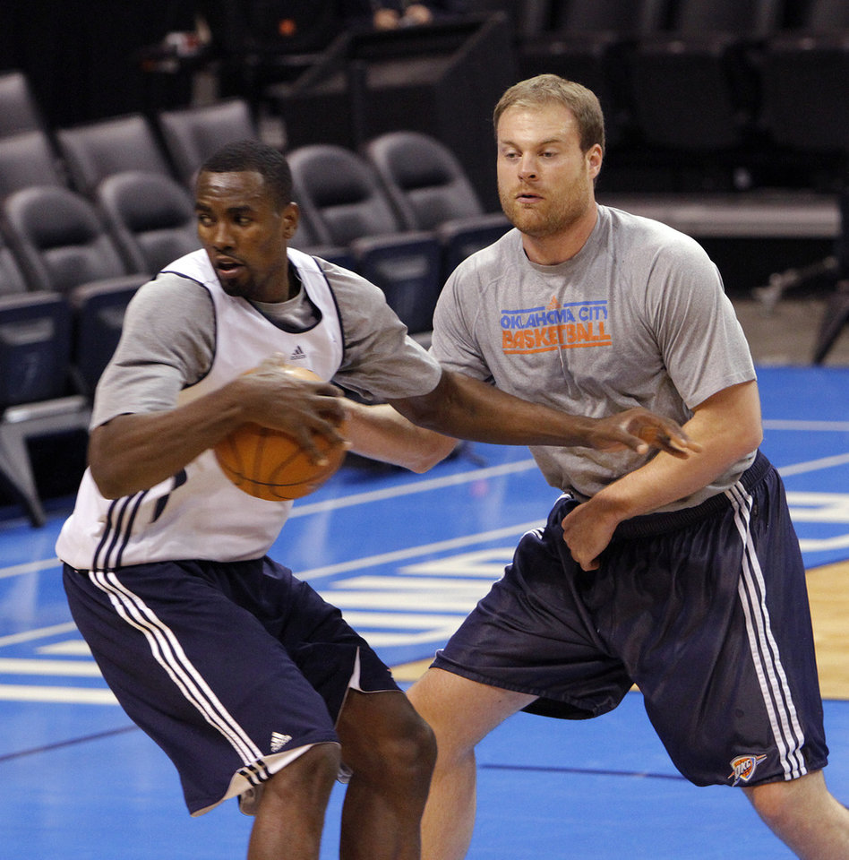 Photo - Dave Bliss goes through drills with Oklahoma City's Serge Ibaka during the NBA Finals practice day at the Chesapeake Energy Arena on Monday, June 11, 2012, in Oklahoma City, Okla. Photo by Chris Landsberger, The Oklahoman