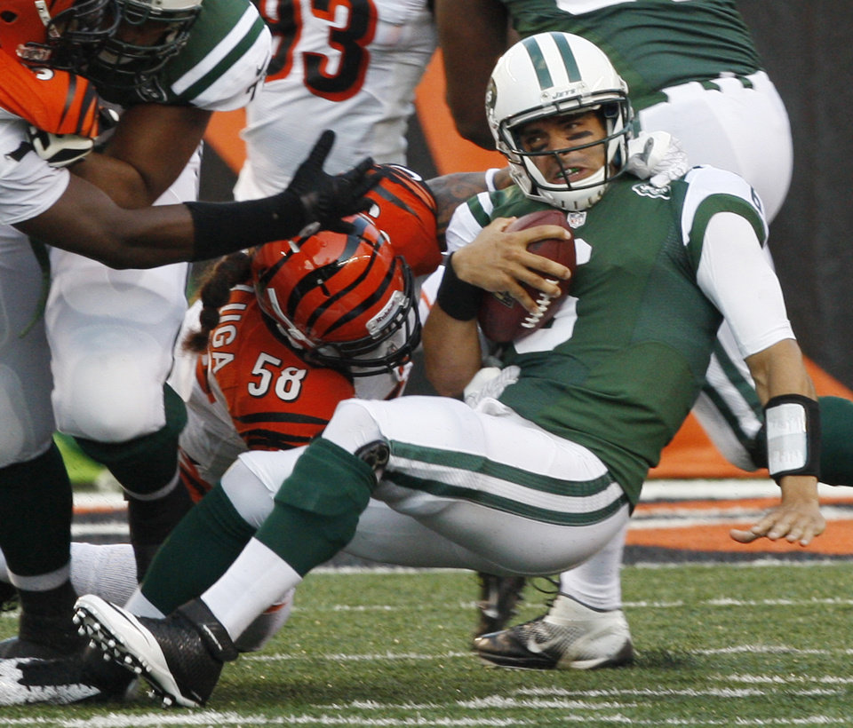 Photo -   New York Jets quarterback Mark Sanchez is sacked by Cincinnati Bengals linebacker Rey Maualuga (58) during the first half of an NFL preseason football game, Friday, Aug. 10, 2012, in Cincinnati. (AP Photo/David Kohl)