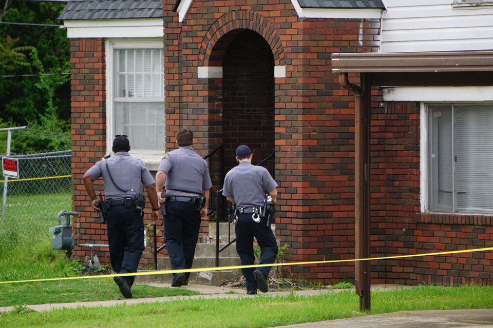 Photo - Oklahoma City police on Thursday investigating the scene where a man was shot to death in northeast Oklahoma City. [Josh Wallace/The Oklahoman]