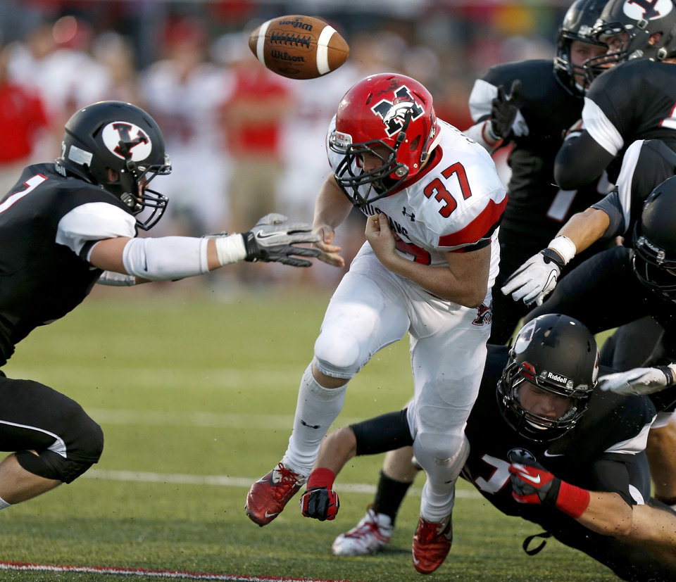 Mustang\'s Cutter Smith loses control of the ball during a high school football game against Yukon in Yukon, Okla., Friday, August 31, 2012. Photo by Bryan Terry, The Oklahoman