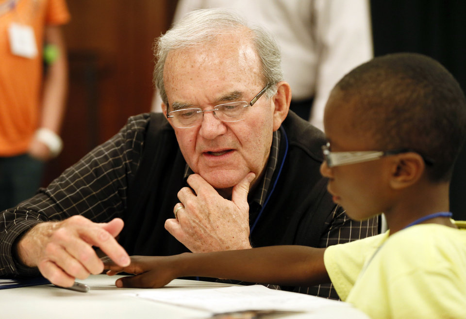 Photo - Jim Fentriss, a volunteer from United Methodist Church of the Servant, works with Isaiah Ramahn, 6, during Whiz Kids at Wesley United Methodist, 1401 NW 25.   NATE BILLINGS - NATE BILLINGS
