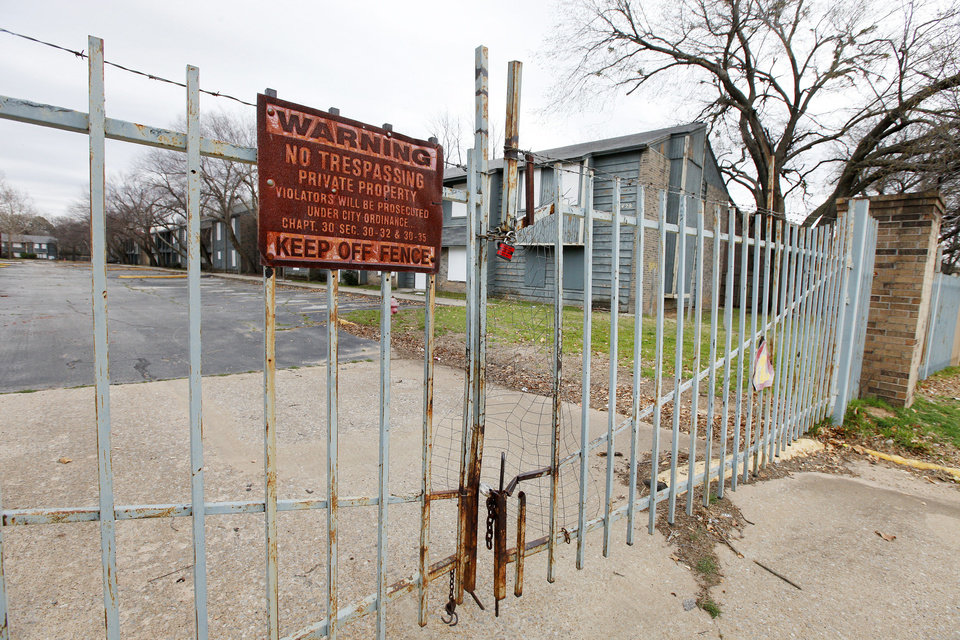 Gates are locked at a dilapidated apartment complex in the 7400 block of NW 10 in Oklahoma City. Photo by Paul B. Southerland, The Oklahoman PAUL B. SOUTHERLAND