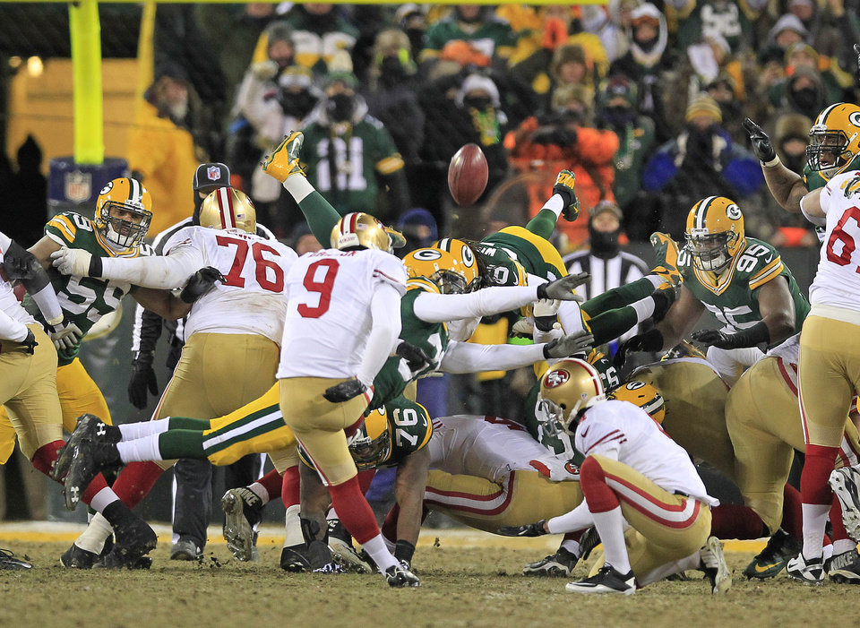 Photo - San Francisco 49ers kicker Phil Dawson (9) kicks his game-winning field goal through the arms of Green Bay Packers cornerback Davon House (31) as the 49ers' 23-20 win at the conclusion of an NFL wild-card playoff football game, Sunday, Jan. 5, 2014, in Green Bay, Wis. (AP Photo/Milwaukee Journal Sentinel, Rick Wood)