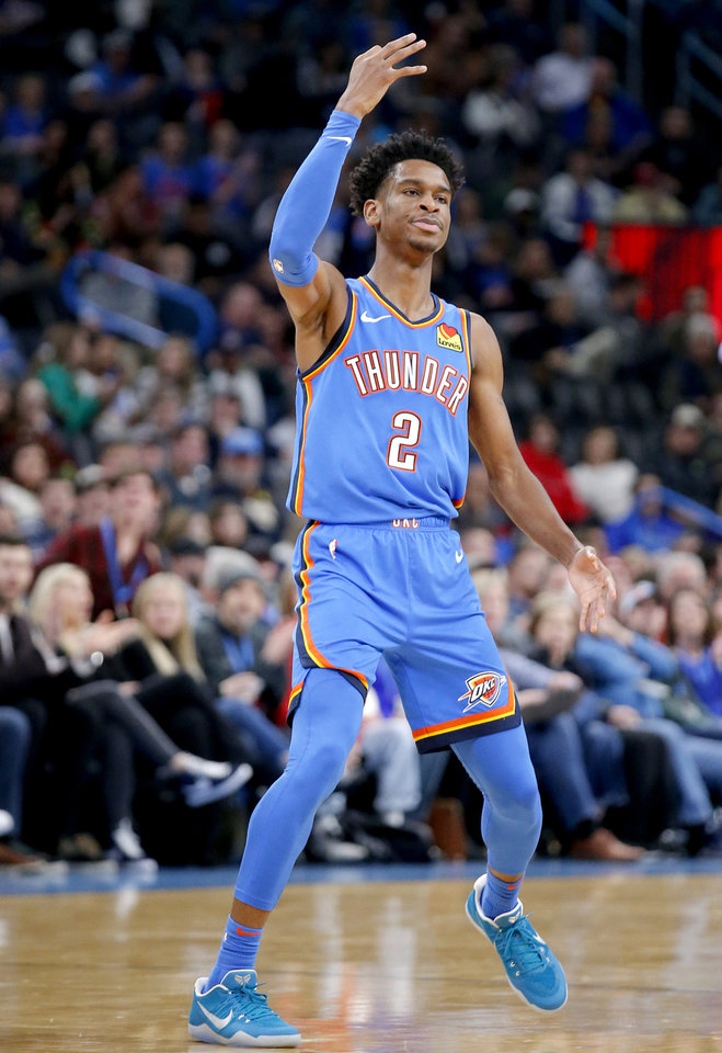 Photo - Oklahoma City's Shai Gilgeous-Alexander (2) celebrates a point during the NBA basketball game between the Oklahoma City Thunder and the Phoenix Suns at the Chesapeake Energy Arena in Oklahoma City , Friday, Dec. 20, 2019.   [Sarah Phipps/The Oklahoman]