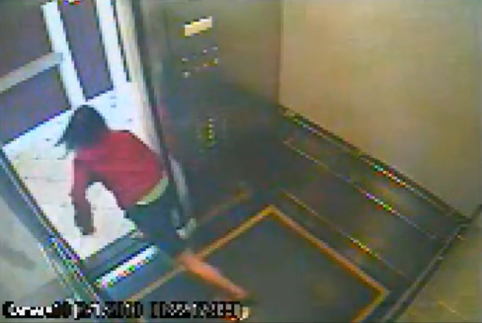 This still image taken from a security video was released on Feb. 13, 2013, by the Los Angeles Police Department in connection with the search for 21-year-old missing Canadian tourist Elisa Lam. In this image, a woman believed to be Lam quickly peeks out the door of an elevator before jumping back inside in the Cecil Hotel in downtown Los Angeles on Thursday, Jan. 31, the last day she was seen alive. A maintenance worker at the hotel found Lam\'s body in a water cistern on the building\'s roof on Feb. 19, more than two weeks after she had gone missing. (AP Photo/Los Angeles Police Department)