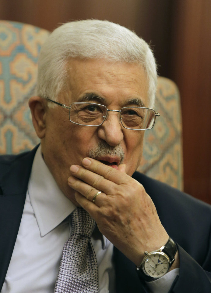 Photo - Palestinian President Mahmoud Abbas listens to Arab League Secretary General Nabil Elaraby, during their meeting at his residence in Cairo, Egypt, Wednesday, July 16, 2014. Talks focused on the ongoing Israeli-Palestinian conflict in Gaza. (AP Photo/Amr Nabil)