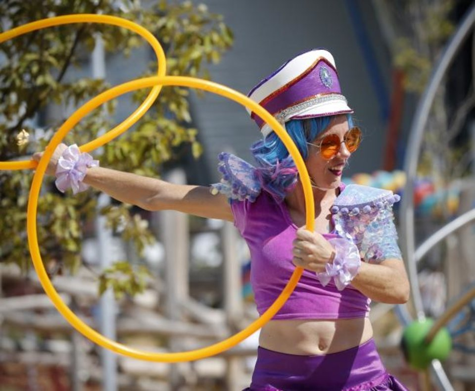 Photo - Chelsea Ryan with Inspyral Circus performs in the children's playground during the grand opening weekend of Scissortail Park in Oklahoma City, Saturday, Sept. 28, 2019. [Nate Billings/The Oklahoman]