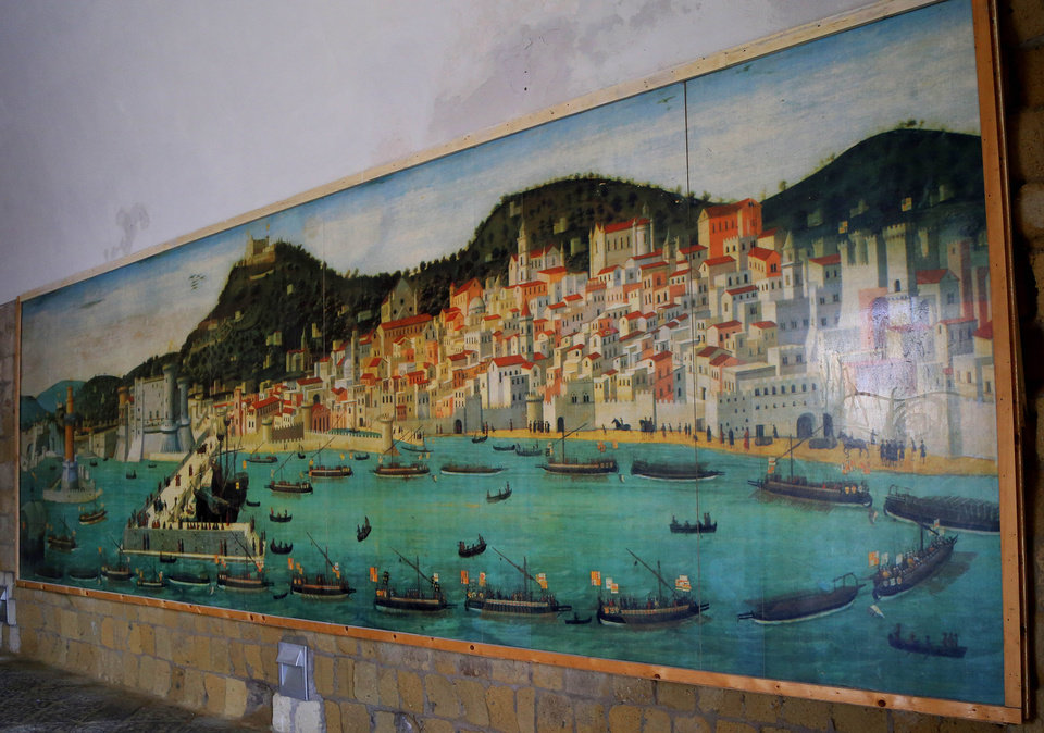 Photo - This May 3, 2014 photo shows a mural of the Bay of Naples at the entrance to Castel dell' Ovo in Naples, Italy. The name means Castle Egg and the fortress is said to be protected by a mythical egg buried in a secret location. (AP Photo/Michelle Locke)