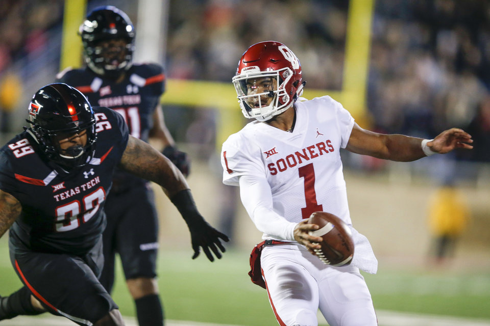 Photo - Oklahoma Sooners quarterback Kyler Murray (1) out runs Texas Tech Red Raiders defensive lineman Preston Gordon (99) during the NCAA football game between the Texas Tech Red Raiders and the Oklahoma Sooners at Jones AT&T Stadium in Lubbock, Texas on Saturday, November 03, 2018. IAN MAULE/Tulsa World