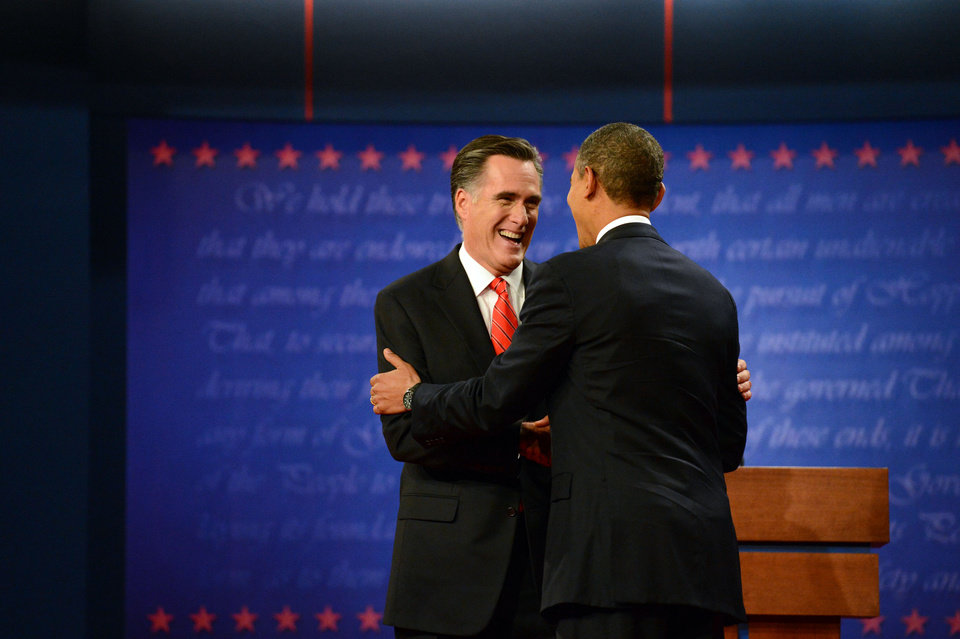Photo - President Barack Obama and former Massachusetts Governor Mitt Romney shake hands at the start of the presidential debate at the University of Denver Wednesday, Oct. 3, 2012, in Denver. (AP Photo/The Denver Post, John Leyba) MAGS OUT; TV OUT; INTERNET OUT ORG XMIT: CODEN212