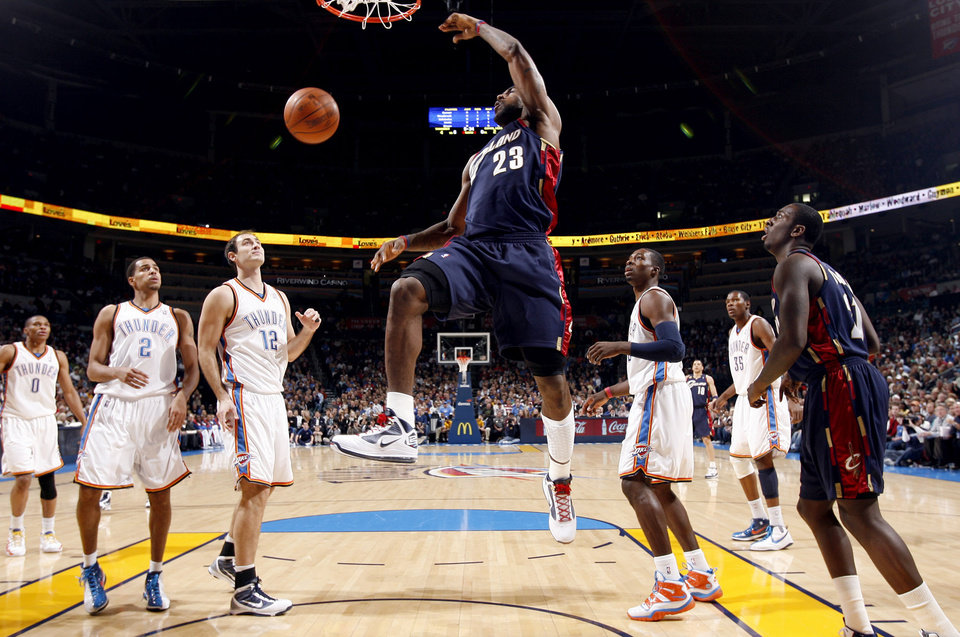 Photo - Cleveland's LeBron James (23) dunks the ball during the NBA game between the Oklahoma City Thunder and the Cleveland Cavaliers, Sunday, Dec. 13, 2009, at the Ford Center in Oklahoma City. Photo by Sarah Phipps, The Oklahoman