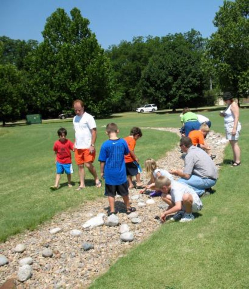 Visitors search for fossils Saturday, June 10, as a part of Dino Daze activities at the Sam Noble Oklahoma Museum of Natural History in Norman.<br/><b>Community Photo By:</b> Scott Butcher<br/><b>Submitted By:</b> Linda, Norman
