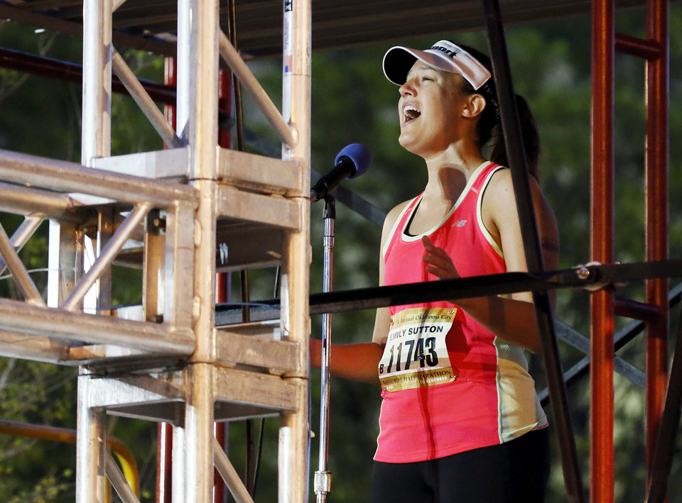 Photo - KFOR meteorologist Emily Sutton sings the national anthem before the Oklahoma City Memorial Marathon in Oklahoma City, Sunday, April 28, 2013. Photo by Nate Billings, The Oklahoman