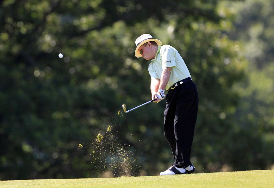 Photo -   Tom Kite hits from the fairway on the ninth hole during the first round at the U.S. Senior Open golf tournament at the Indianwood Golf and Country Club in Lake Orion, Mich., Thursday, July 12, 2012. (AP Photo/Carlos Osorio)