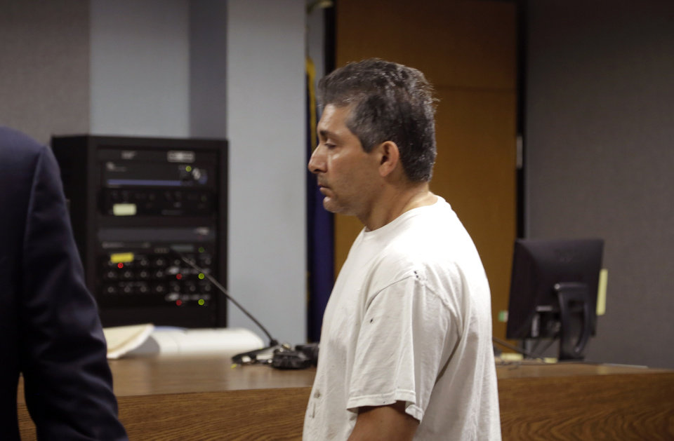 Photo - Sebastiano Quagliata, 45 of Metamora Township, Mich. appears in District Court in Lapeer, Mich., Friday, Aug. 1, 2014. Bond has been set at $500,000 for a Quagliata and his wife, Valbona Lucaj, 44, who are charged with second-degree murder after their dogs fatally mauled a 46-year-old jogger on a rural Michigan road on July 23. (AP Photo/Detroit Free Press, Kathleen Galligan)  DETROIT NEWS OUT;  NO SALES
