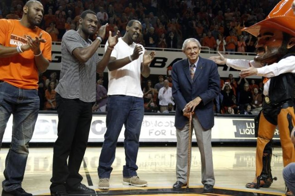 Photo -  Joey Graham, Tony Allen, Ivan McFarlin and Pistol Pete introduce coach Eddie Sutton during the 2014 Bedlam men's basketball game in Stillwater. [Sarah Phipps/The Oklahoman]