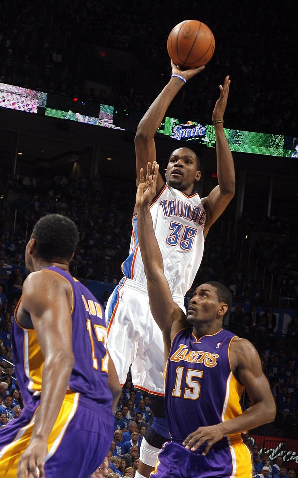 Oklahoma City\'s Kevin Durant (35) shoots as Los Angeles\' Metta World Peace (15) and Los Angeles\' Andrew Bynum (17) defend during Game 1 in the second round of the NBA playoffs between the Oklahoma City Thunder and the L.A. Lakers at Chesapeake Energy Arena in Oklahoma City, Monday, May 14, 2012. Photo by Sarah Phipps, The Oklahoman