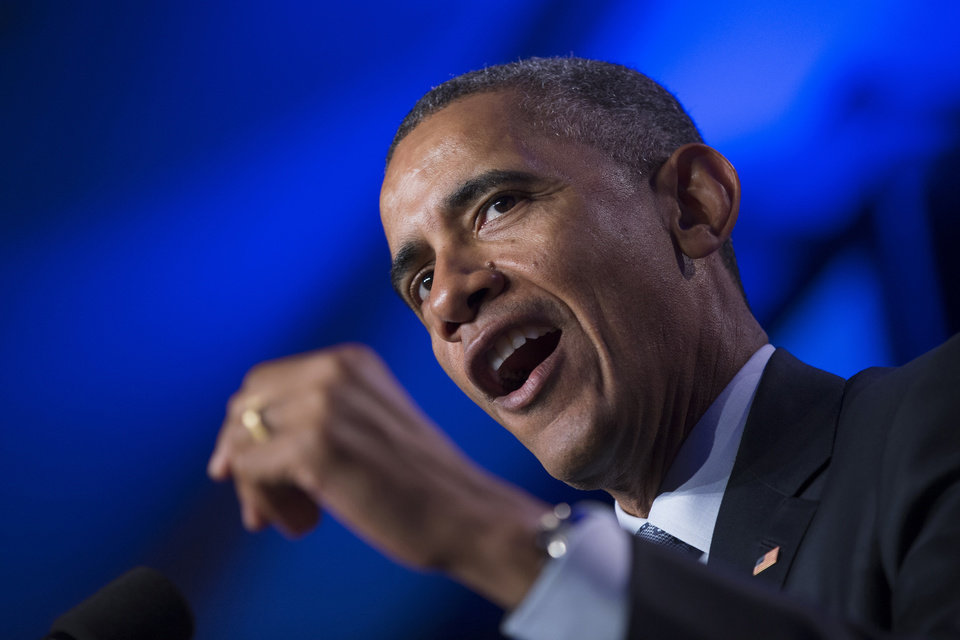 Photo - FILE - In this Feb. 20, 2015 file photo, President Barack Obama speaks in Washington. The rich aren't taxed enough and the middle-class is taxed too much. As for your taxes, you probably think they're too high as well. Those are the results of a new Associated Press-GfK poll, which found that most Americans support President Barack Obama's proposal to raise investment taxes on high-income families. The findings echo the populist messages of Sens. Elizabeth Warren and Bernie Sanders, two liberals being courted by the progressive wing of the Democratic Party to run for president in 2016. The findings also add weight to Obama's new push to raise taxes on the rich and use some of the revenue to lower taxes on the middle class.  (AP Photo/Evan Vucci, File)