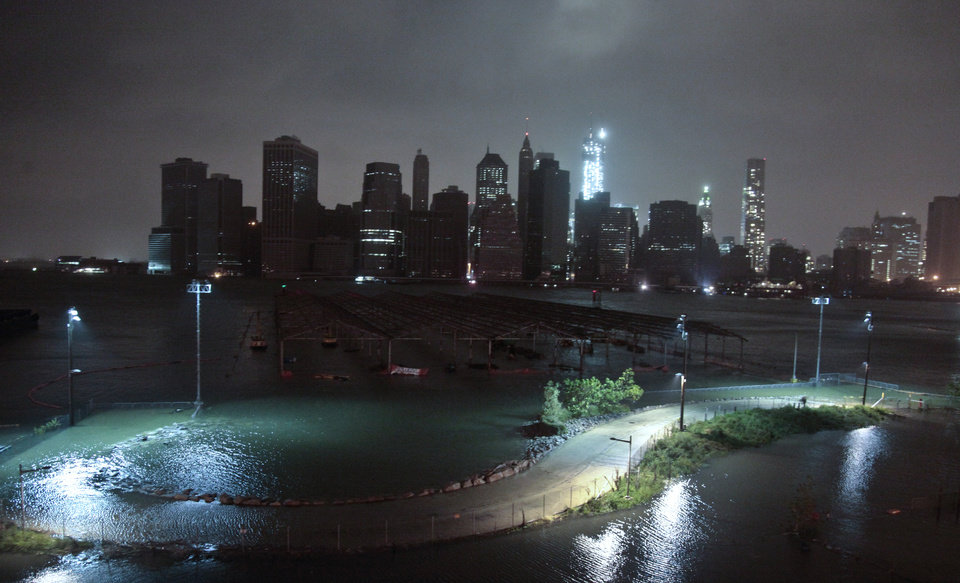 Photo -   Lower Manhattan goes dark during hurricane Sandy, on Monday, Oct. 29, 2012, as seen from Brooklyn, N.Y. Sandy continued on its path Monday, as the storm forced the shutdown of mass transit, schools and financial markets, sending coastal residents fleeing, and threatening a dangerous mix of high winds and soaking rain. (AP Photo/Bebeto Matthews)