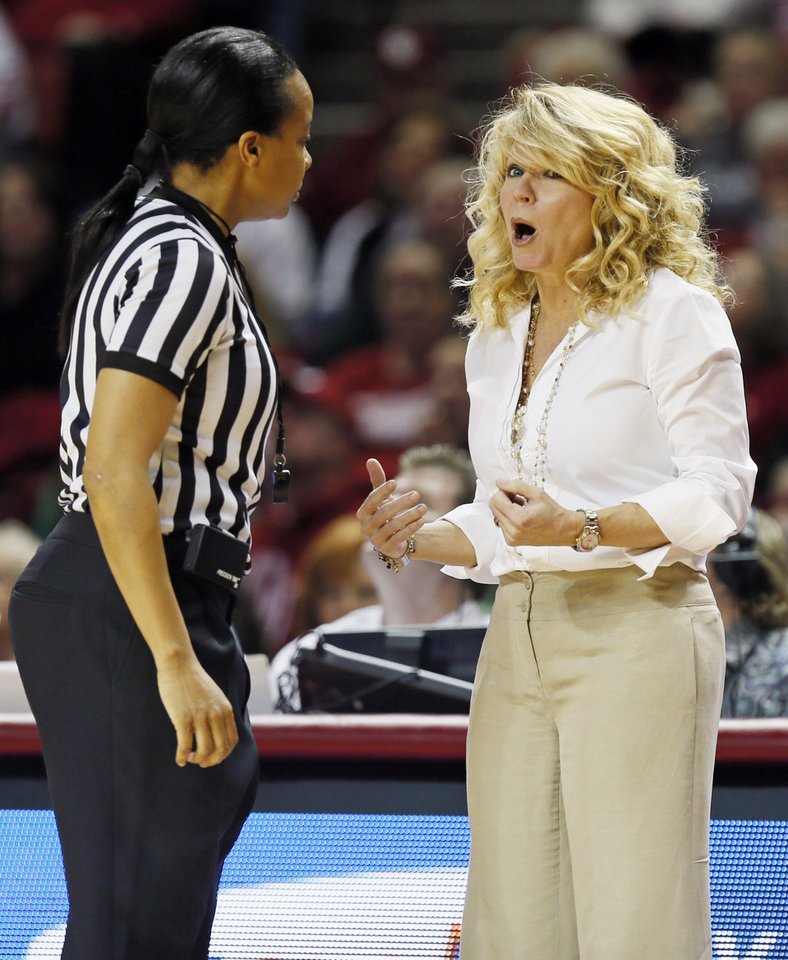 Photo - OU head coach Sherri Coale discusses a call with an official in the first half during a women's Bedlam college basketball game between the Oklahoma State University Cowgirls (OSU) and the University of Oklahoma Sooners (OU) at Lloyd Noble Center in Norman, Okla., Saturday, Feb. 1, 2014. Photo by Nate Billings, The Oklahoman