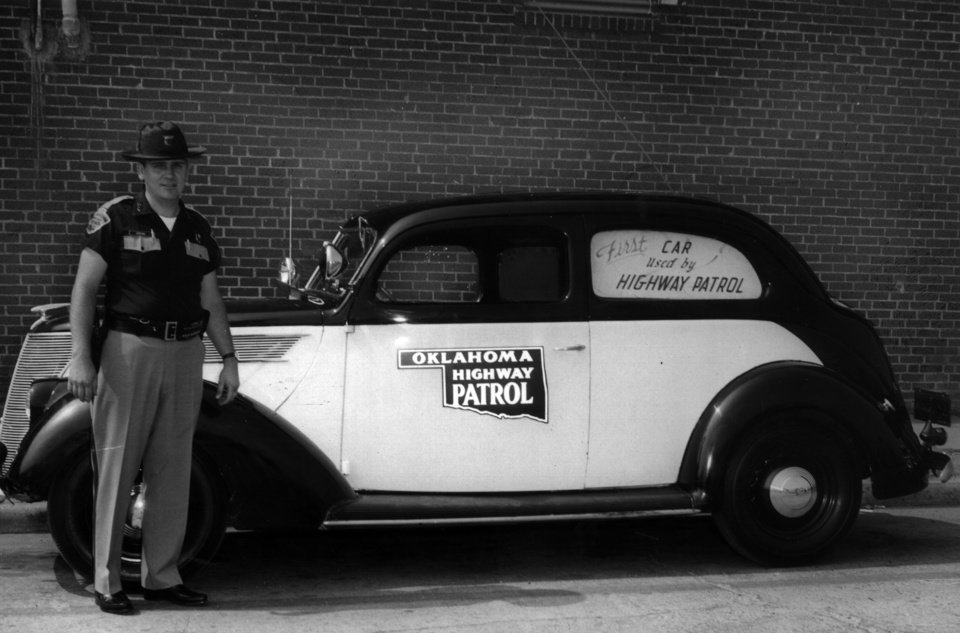 Photo - Trooper Ray Jordan of Seminole, stands next to a 1937 Ford, the Oklahoma Highway Patrol's first car. Jordan was returning from showing off the car at an exhibition in 1966 when he used it to pull over a suspected drunk driver.  PARKS DRUG - PARKS DRUG