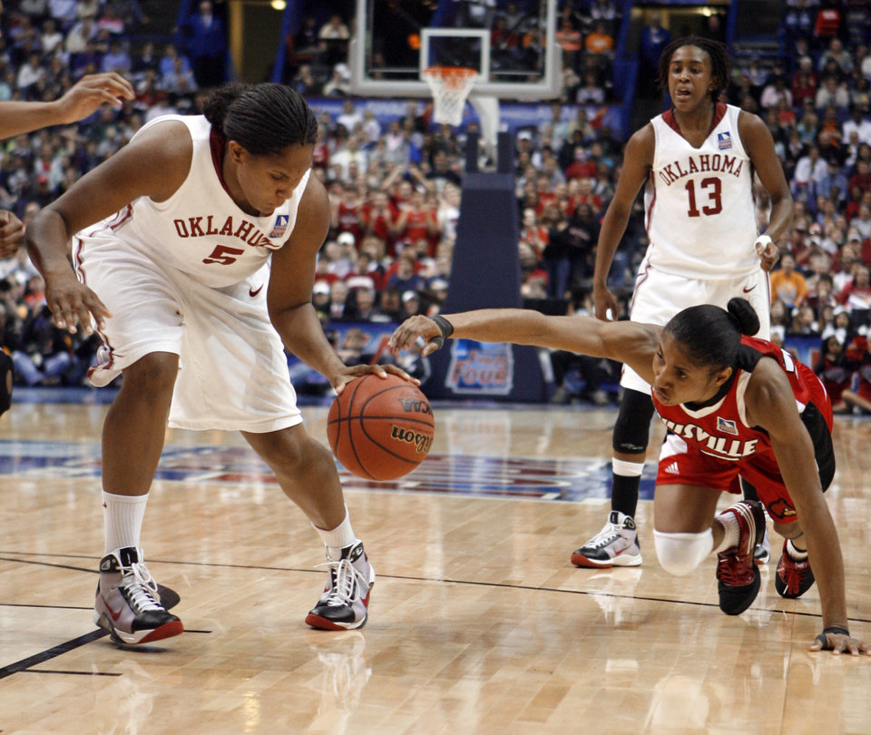 Photo - Ashley Paris recovers a ball knocked loose by Angel McCoughtry and takes the ball to the lane for two points in the second half as the University of Oklahoma plays Louisville at the 2009 NCAA women's basketball tournament Final Four in the Scottrade Center in Saint Louis, Missouri on Sunday, April 5, 2009. Photo by Steve Sisney, The Oklahoman