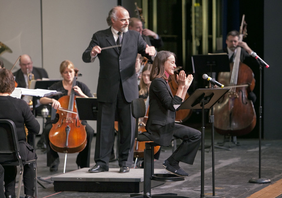 Photo - Composer Libby Larsen, seated, introduces an anthem she wrote especially for Norman as conductor Richard Zielinski directs the city's new orchestra, the Norman Philharmonic. PHOTO BY STEVE SISNEY, THE OKLAHOMAN