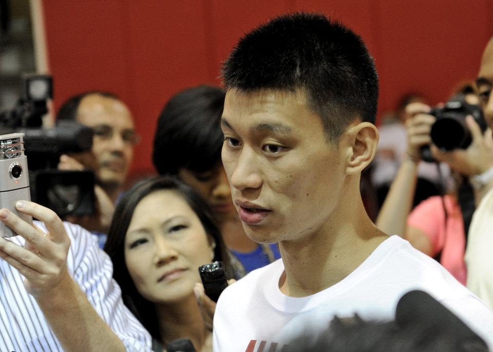 Photo -   Houston Rockets' player Jeremy Lin speaks with the media after NBA basketball practice, Tuesday, Sept. 18, 2012, in Houston. (AP Photo/Pat Sullivan)