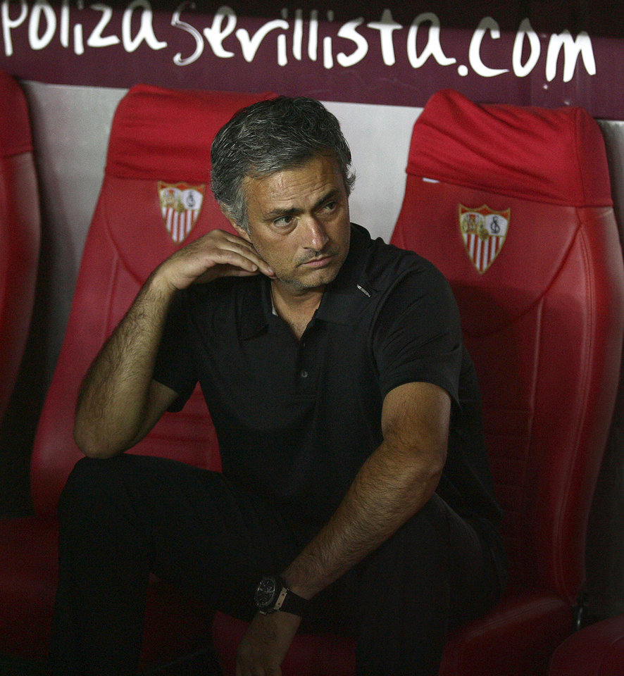 Photo -   In this photo taken Saturday Sept. 15, 2012. Real Madrid's coach Mourinho from Portugal looks on during their La Liga soccer match against Sevilla at the Ramon Sanchez Pizjuan stadium, in Seville, Spain. (AP Photo/Angel Fernandez)