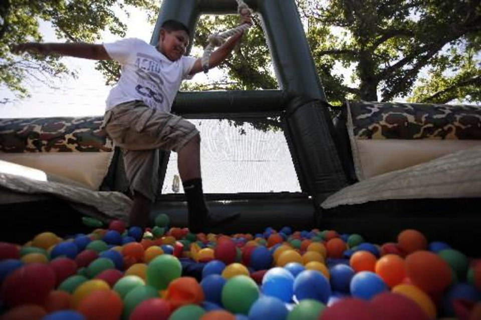 Photo - Austin Blythe, 12, of Earlsboro, goes through an obstacle course at a Fourth of July Celebration in Seminole, Okla., July 4, 2012. Photo by Garett Fisbeck, The Oklahoman