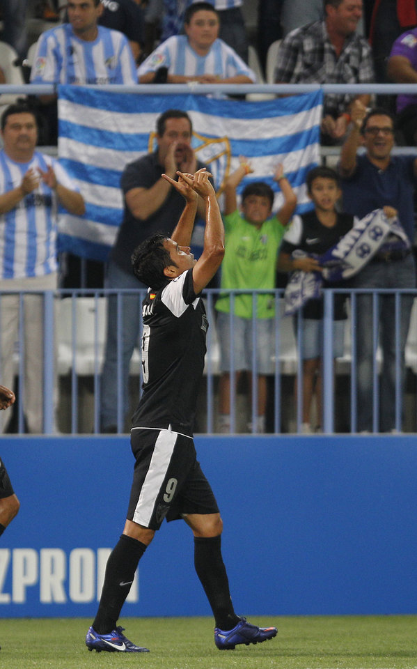 Photo -   Malaga's Javier Saviola from Argentina, reacts after scoring a goal against Zenit St Petersburg during the group C Champions League soccer match at the Rosaleda stadium in Malaga, Spain, Tuesday, Sept. 18, 2012. (AP Photo/Sergio Torres)