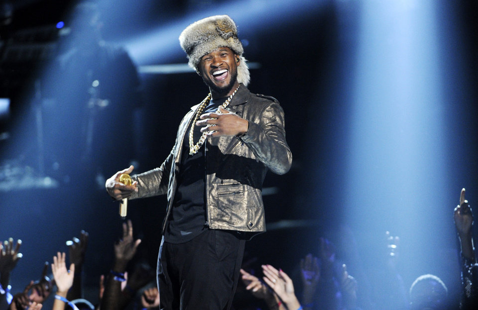 Photo - Usher performs at the BET Awards at the Nokia Theatre on Sunday, June 29, 2014, in Los Angeles. (Photo by Chris Pizzello/Invision/AP)