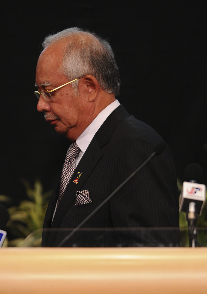 Photo - Malaysian Prime Minister Najib Razak leaves after a press conference for the missing Malaysia Airlines, flight MH370, in Kuala Lumpur, Malaysia, Monday, March 24, 2014. A new analysis of satellite data indicates the missing Malaysia Airlines plane crashed into a remote corner of the Indian Ocean, Najib said Monday. (AP Photo/Joshua Paul)