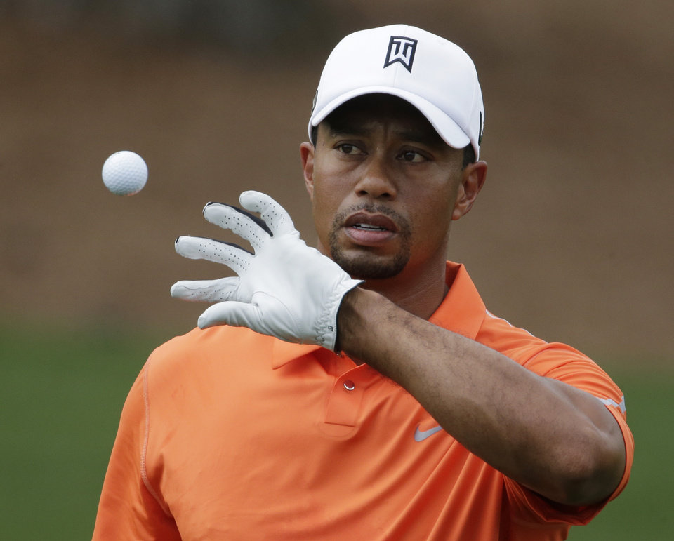 Tiger Woods catches a ball while hitting on the driving range during a practice round for the Masters golf tournament Monday, April 8, 2013, in Augusta, Ga. (AP Photo/Charlie Riedel) ORG XMIT: AUG176