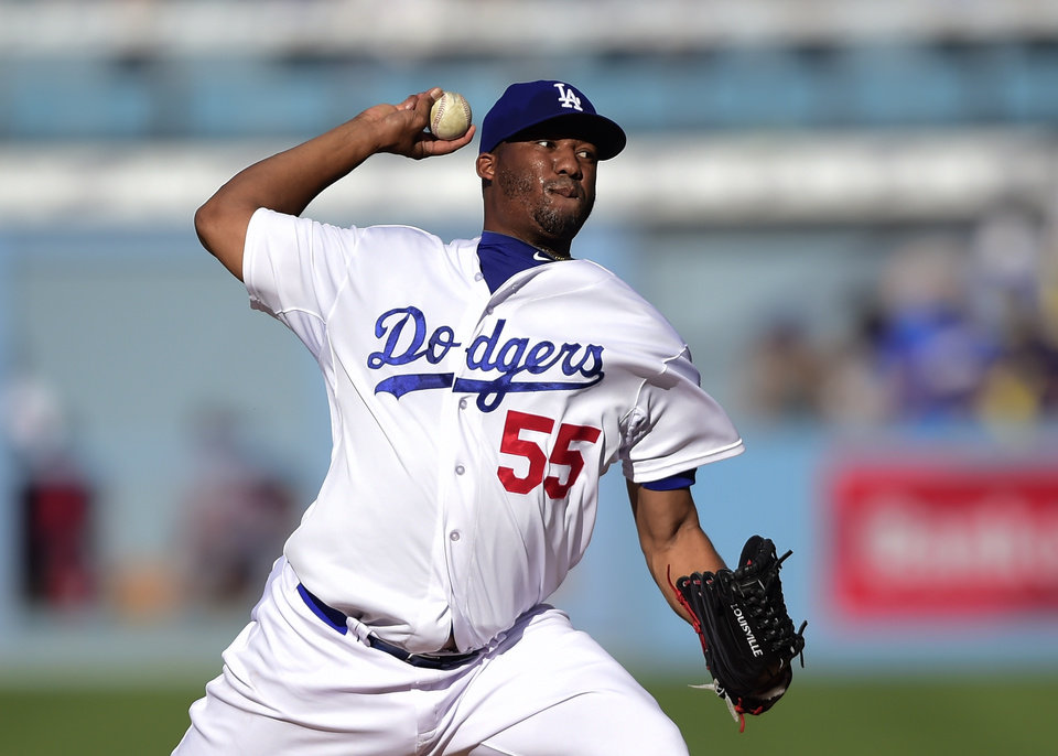 Photo - Los Angeles Dodgers Roberto Hernandez pitches in the first inning of a baseball game against the Washington Nationals, Monday, Sept. 1, 2014, in Los Angeles. (AP Photo/Gus Ruelas)
