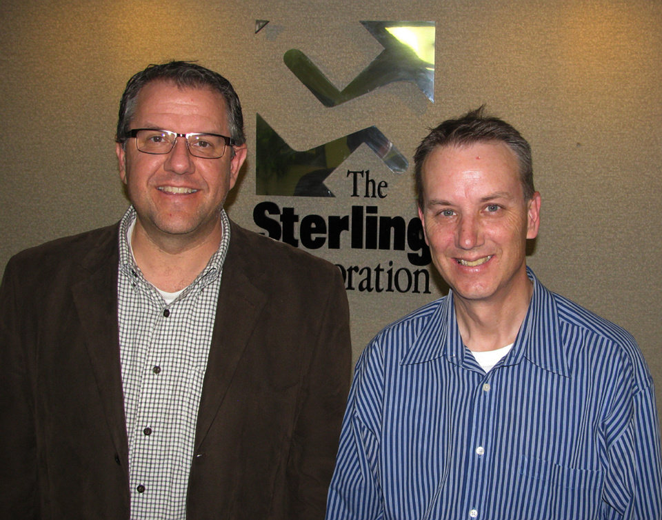 Republican consultants Jeff Timmer and Mark Pischea of The Sterling Corp., pose for a photo Friday, May 4, 2012, in Lansing, Mich. Timmer and Pischea have joined in an unusual partnership with Democratic consultants at Byrum & Fisk Advocacy Communications to promote a November ballot issue that would increase renewable energy requirements. (AP Photo/Kathy Barks Hoffman)