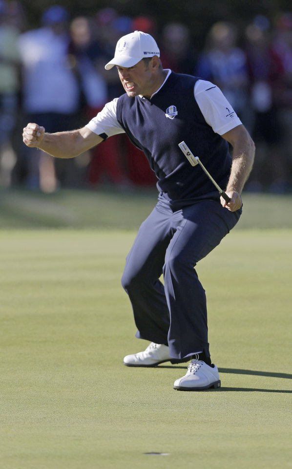 Europe's Lee Westwood reacts after making a birdie putt on the 15th hole during a singles match at the Ryder Cup PGA golf tournament Sunday, Sept. 30, 2012, at the Medinah Country Club in Medinah, Ill. (AP Photo/Chris Carlson)  ORG XMIT: PGA177
