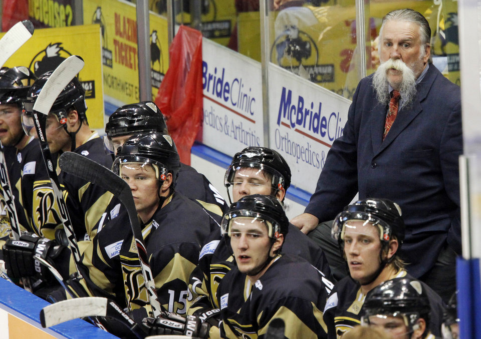 Photo - Oklahoma City head coach Doug Sauter and his team watch the action on the ice during the Oklahoma City Blazers CHL hockey game against the Bossier-Shreveport Mudbugs at the Ford Center in Oklahoma City, Wednesday, February 25, 2009. BY NATE BILLINGS, THE OKLAHOMAN ORG XMIT: KOD
