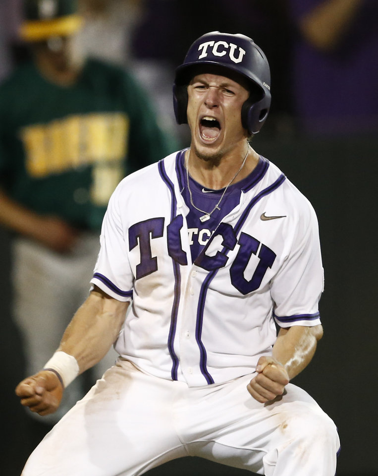 Photo - TCU's Cody Jones celebrates after scoring on the game-winning hit by teammate Boomer White against Siena during an NCAA college baseball regional tournament game in Fort Worth, Texas, Friday, May 30, 2014. TCU won in eleven innings 2-1. (AP Photo/Jim Cowsert)