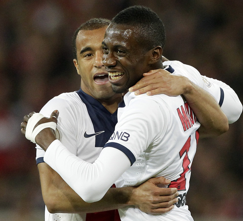 Photo - PSG's Blaise Matuidi, right, reacts with PSG's Lucas after scoring the third goal during his French League one soccer match at the Lille Metropole stadium, in Villeneuve d'Ascq, northern France, Saturday, May 10, 2014. Paris Saint-Germain have  won their second straight French league title. (AP Photo/Michel Spingler)