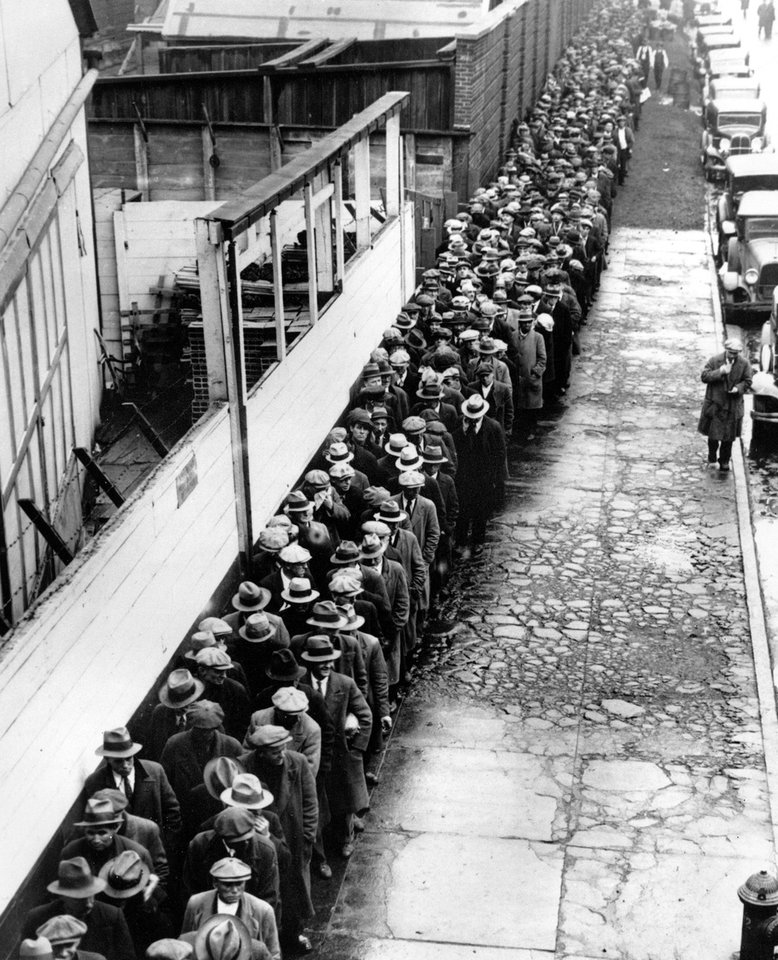 Photo - FOOD LINE, BREAD LINES:  ** FILE ** In this 1932 file photo, long line of jobless and homeless men wait outside to get free dinner at New York's municipal lodging house during the Great Depression.  (AP File Photo) ORG XMIT: NYBZ197