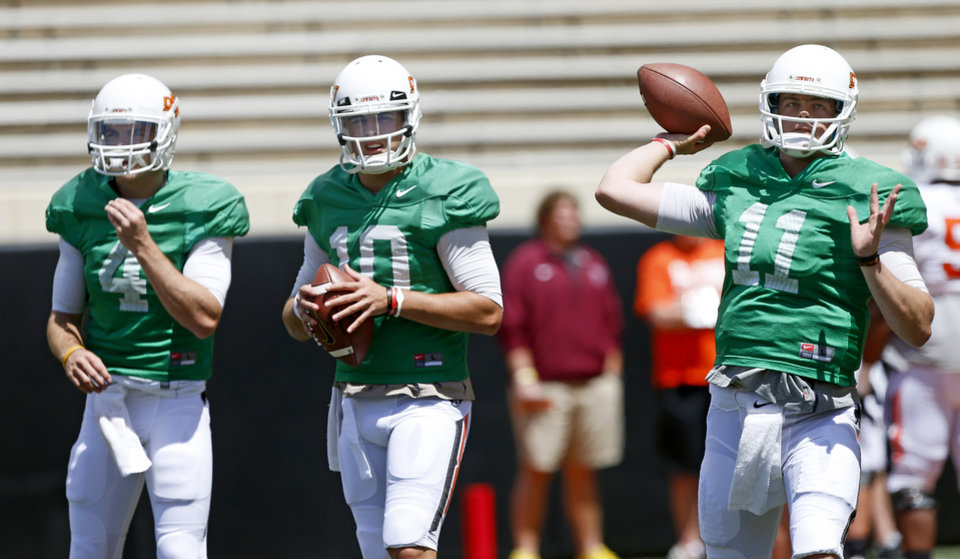 Oklahoma State quarterbacks , J.W. Walsh, left, Clint Chelf, and Wes Lunt warm up before OSU's spring football game at Boone Pickens Stadium in Stillwater, Okla., Sat., April 20, 2013. Photo by Bryan Terry, The Oklahoman