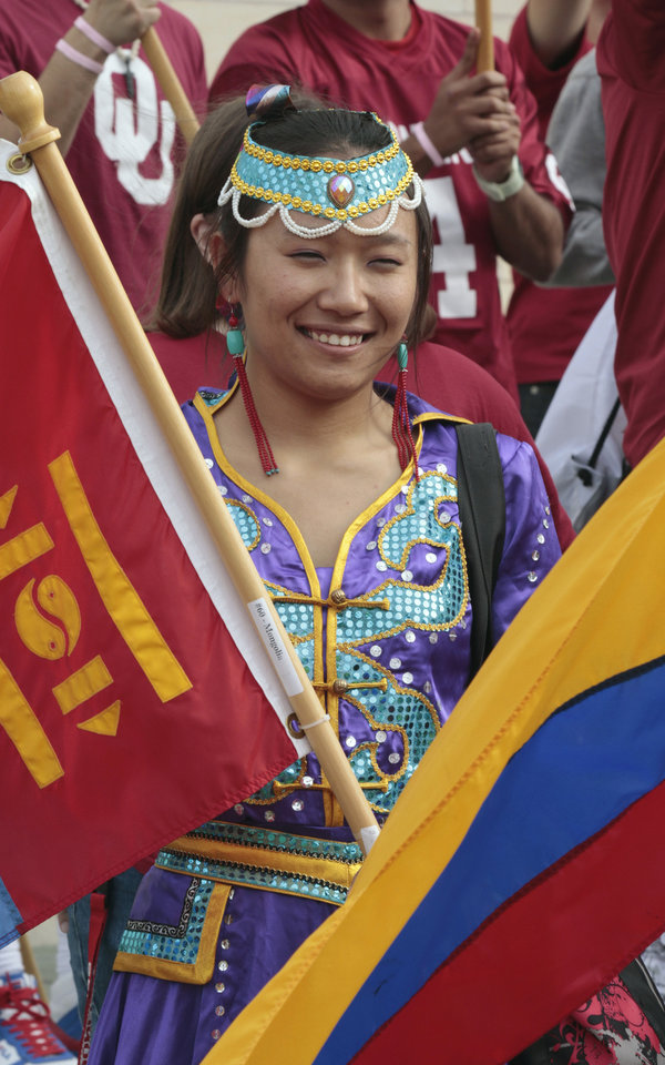 Photo - Foreign exchange student Xi Lintana wears the costume of her native Mongolia during the homecoming parade prior to the University of Oklahoma Sooners (OU) game with the Texas Tech University Red Raiders (TTU) on Saturday, Oct. 22, 2011. in Norman, Okla. Photo by Steve Sisney, The Oklahoman